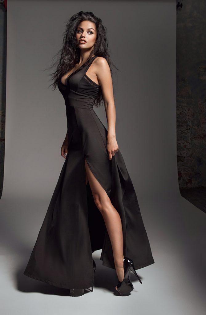 Beautiful woman wearing a black dress