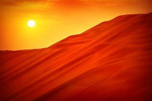 Orange sand dunes in the desert