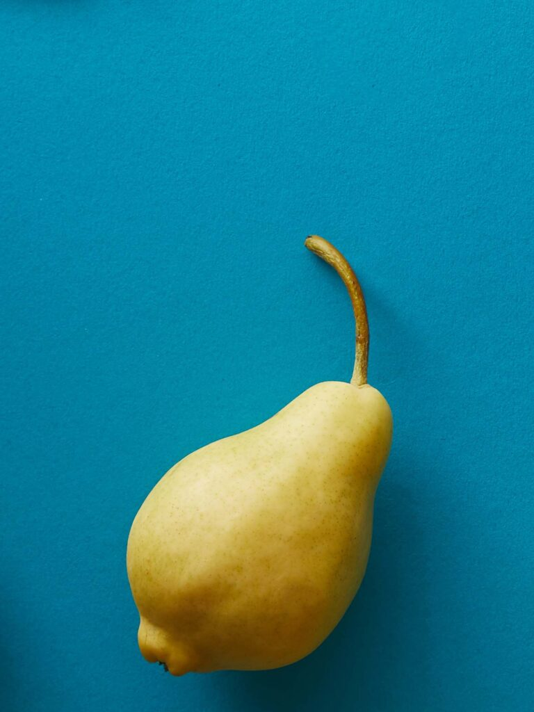 Yellow pear on blue background