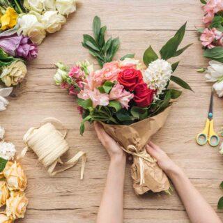 Florist making a bouquet of different flower colors