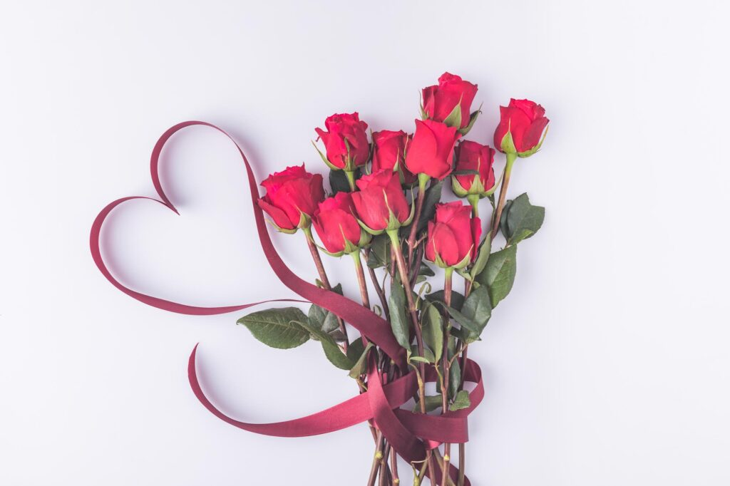 Red roses bouquet and a heart ribbon