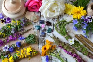 Witchery scrolls, herbs, flowers, and candles