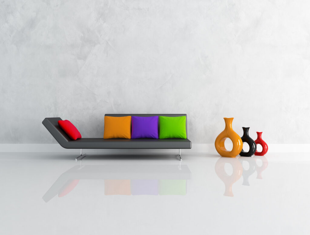 Black couch with red, orange, purple, and green pillows, which are square colors