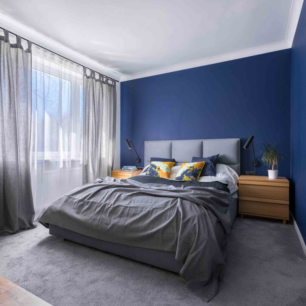 Modern bedroom painted in blue, one of the best colors that are relaxing