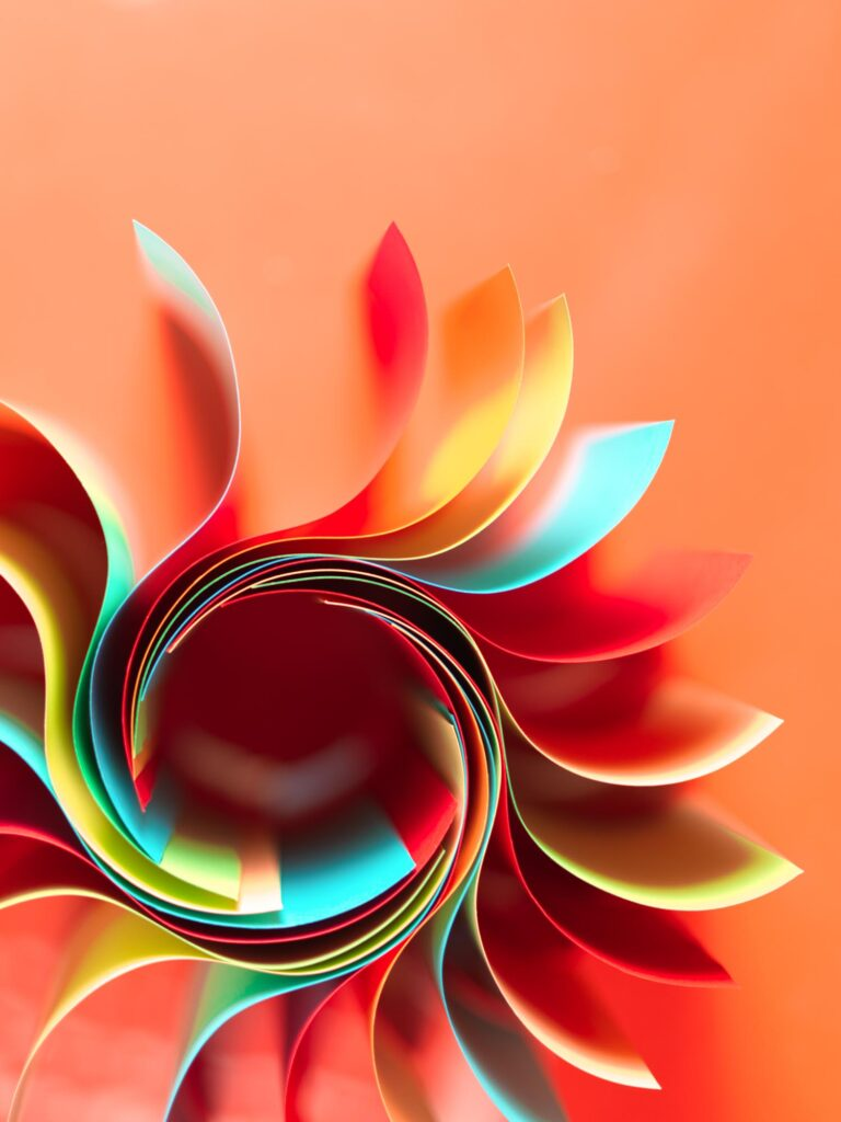 Green, red, blue curved paper on orange background