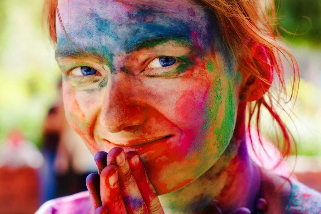 Woman with colorful paint on her face