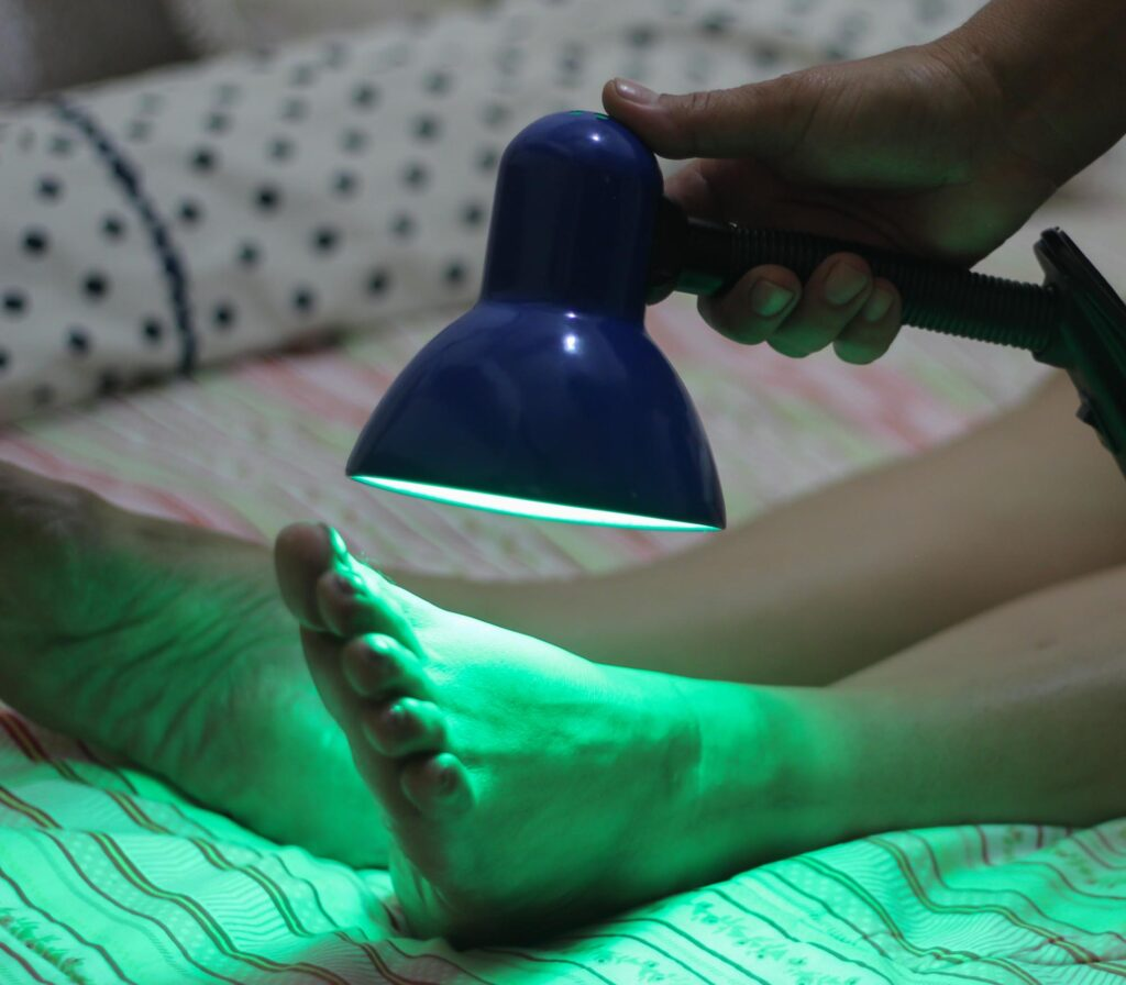 Woman doing color therapy with green light