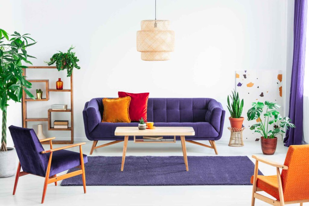 Indigo couch with red and orange pillows