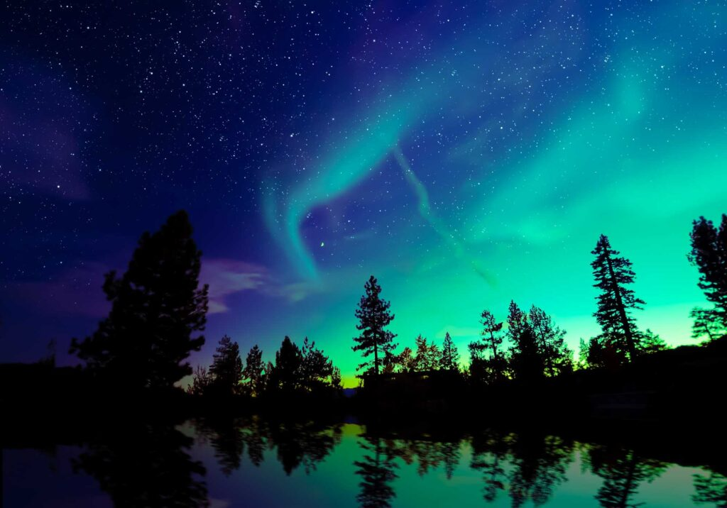 Purple, blue, and green northern lights, made of analogous colors