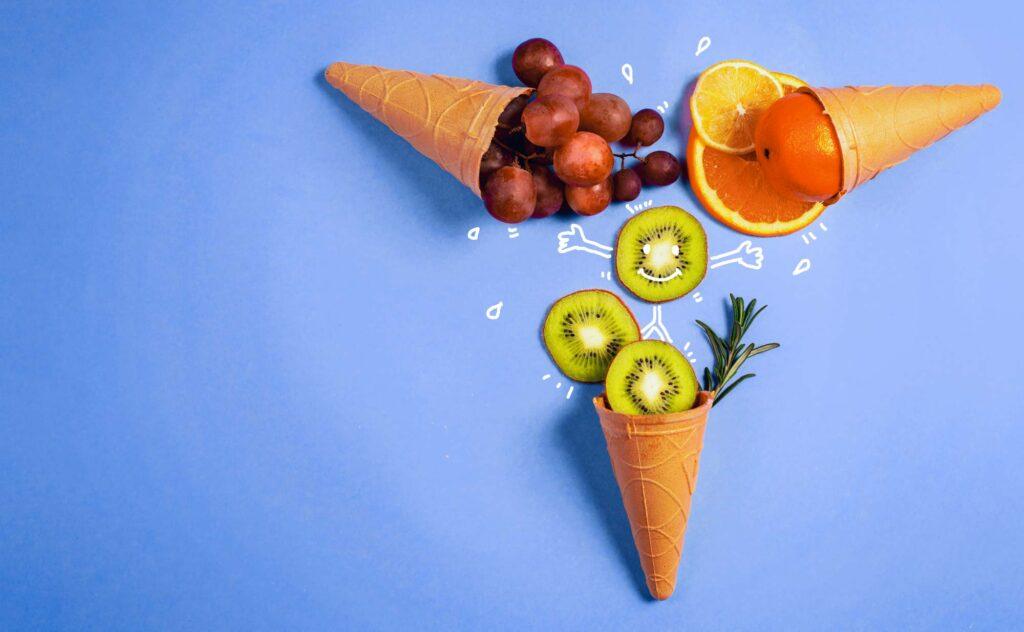 Orange and green fruit ice cream on blue background