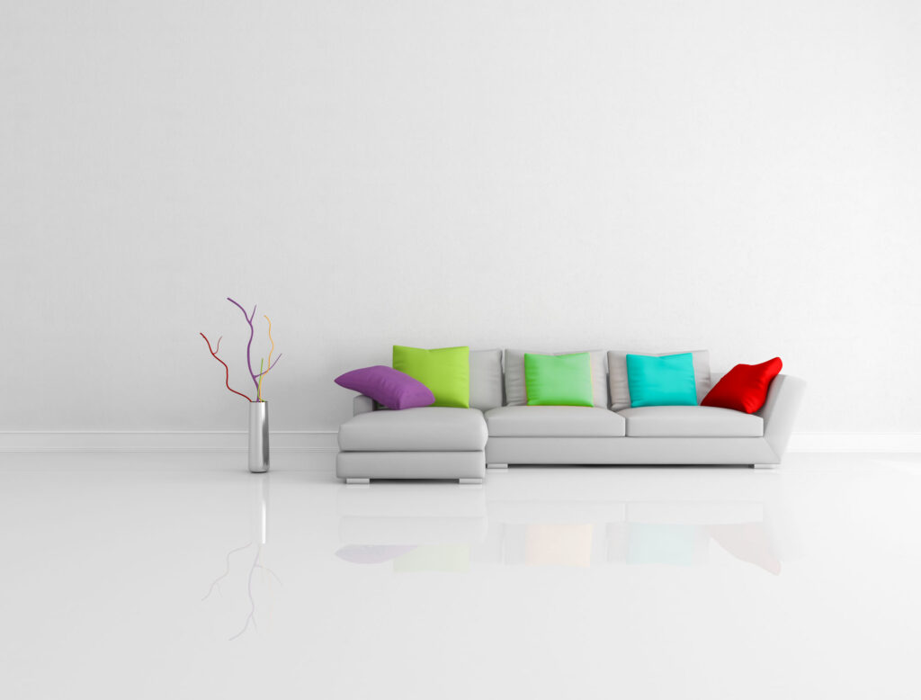Gray couch with red, cyan, purple, and green pillows, which are square colors