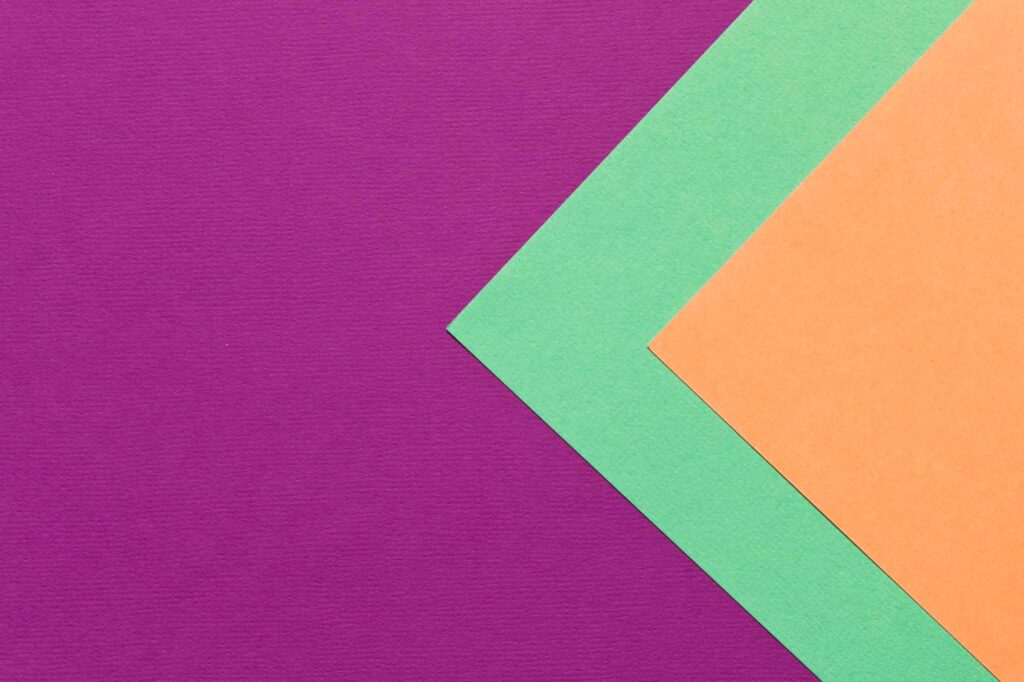Purple, green, and orange piece of papers are great examples of triadic colors