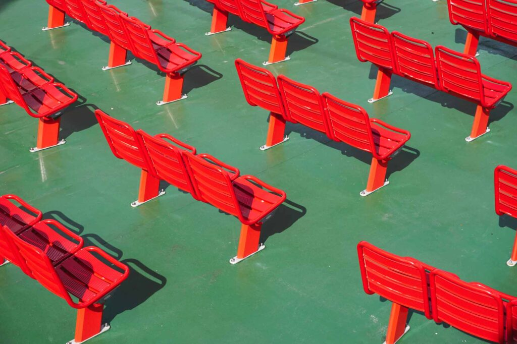 Red benches on green floor