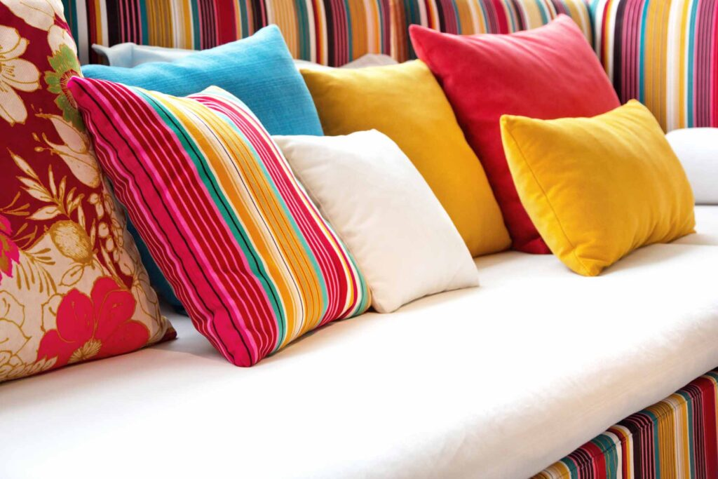 Red, yellow, and blue pillows