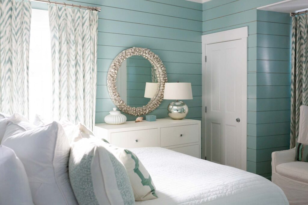 Beach house bedroom wall painted in teal, a relaxing color