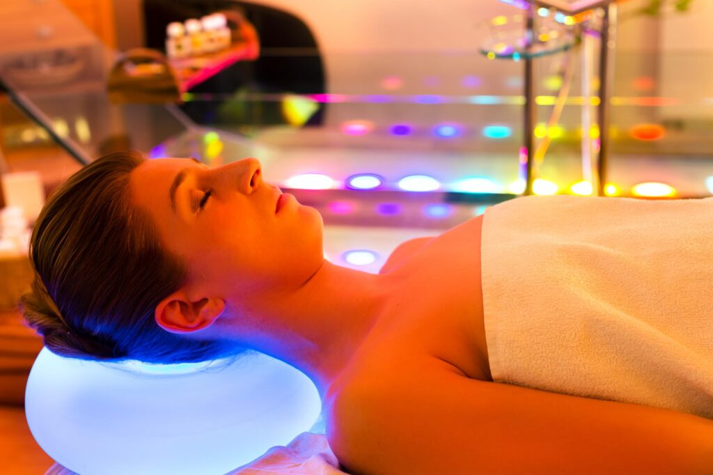 Woman doing color therapy in spa